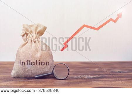Inflation Concept. Bag With A Magnifying Glass And An Up Arrow..