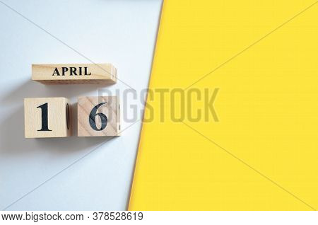 April 16, Empty White - Yellow Background With Number Cube.