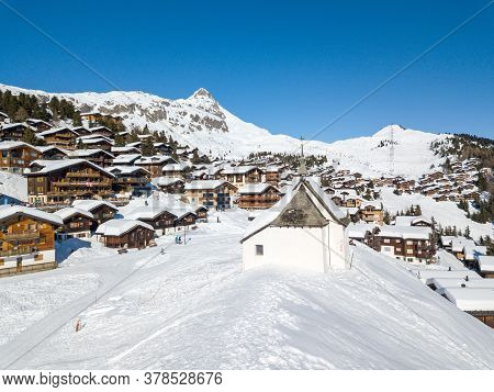 Bettmeralp, Switzerland - February 16. 2019: Aerial Image Of The Chapel Maria In Snow (kapelle Zum S