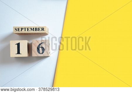 September 16, Empty White - Yellow Background With Number Cube.