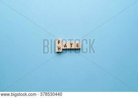 The Concept Of Hate And Fate. Letters On A Blue Background