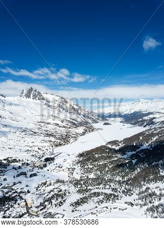 Aerial View By Drone Over The Engadin Valley With Ski Resorts St. Moritz Lakes And Maloja, Swiss Alp