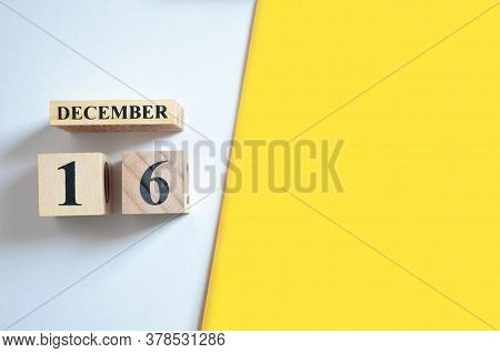 December 16, Empty White - Yellow Background With Number Cube.