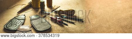 Leather Crafting And Tools For Crafting Leather Goods. Large Banner For A Site With Leather Products