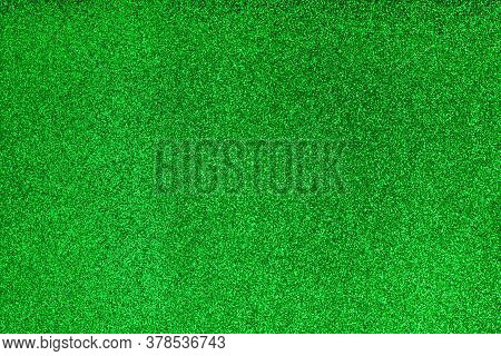 Blurred Defocused Green Wallpaper. Party Decoration. Holiday Glowing Sparkles. Abstract Vibrant Fest
