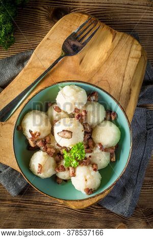 Meat Stuffed Potato Dumplings With Fried Onion And Greaves.