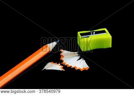 Pencil,pencil Sharpener And Pencil Shavings Isolated Against A Black Background
