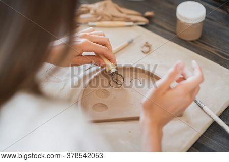 Professional Female Potter Shaping And Carving Parts Pottery Workshop, Studio. Crafting, Artwork And