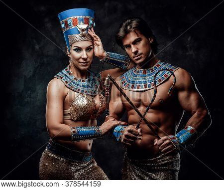 Woman In Egyptian Costume With Her Arm Laid On Male Shoulder. Man Holds The Traditional Egyptian Sig