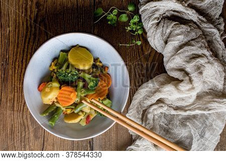 Stewed Vegetables In Ceramic Bowls On Wooden Table.