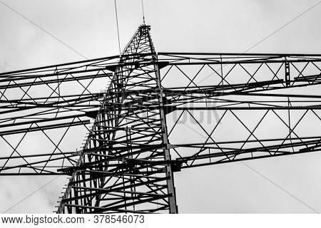 Electricity Pylon From Below Siluette In The Sky
