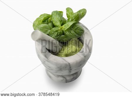 Carrara Marble Mortar And Pestle With Genoese Italian Pesto And Green Basil Leaves Isolated On White