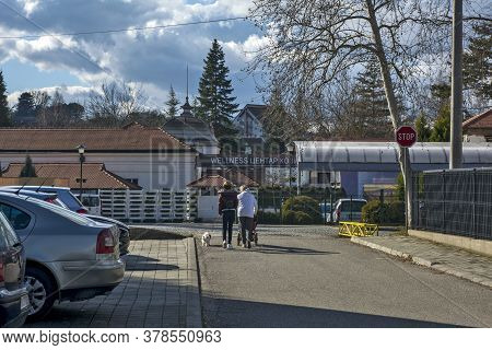 Banja Koviljača, Serbia, February 15, 2020. Family On A Walk In Front Of The Wellness Center. They T