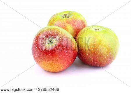 Three Apple On A White Background. Healthy Food. Ripe Organic Apple.
