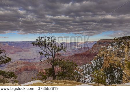 Panoramic View From South Cliff Of Grand Canyon With Dramatic Cloud Formations In Winter