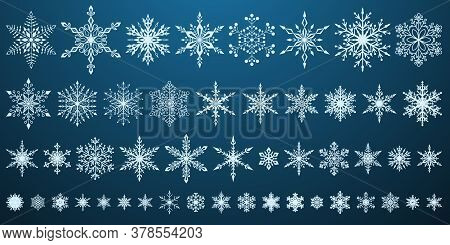 Set Of Beautiful Complex Christmas Snowflakes, White On Blue Background