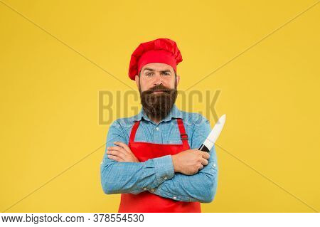 Feel Fine Dining. Best Menu Offer. Confident Bearded Happy Chef Red Uniform. Male Chef Cut With Knif