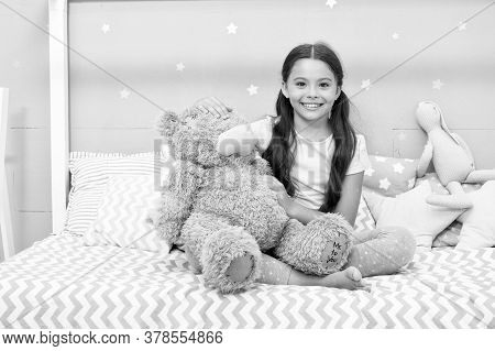 Imaginary Interaction. Play Games. Favorite Toy. Girl Child Hug Teddy Bear In Her Bedroom. Pleasant