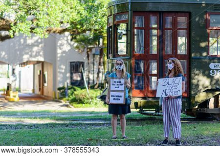 New Orleans, Louisiana/usa - 6/12/2020: Demonstrators For Black Lives Matter Stand In Front Of Passi