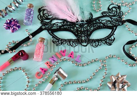 Various Accessories For Parties And Masquerades On A Soft Blue Background