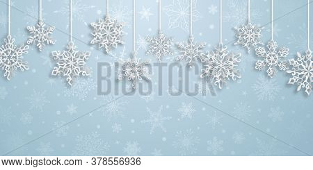 Christmas Background With Hanging Paper Snowflakes With Soft Shadows On Light Blue Background