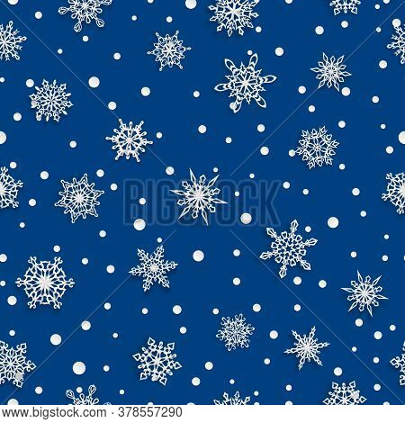 Christmas Seamless Pattern Of Paper Snowflakes With Soft Shadows On Blue Background