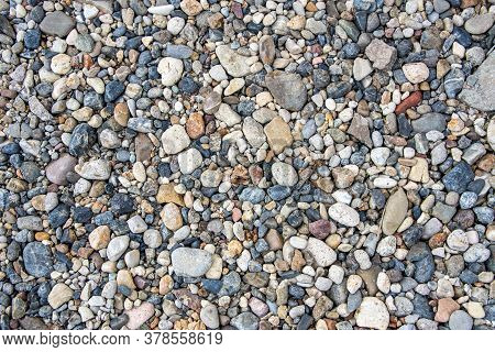 Small Multi-colored Pebbles Texture Background. Colorful Stones
