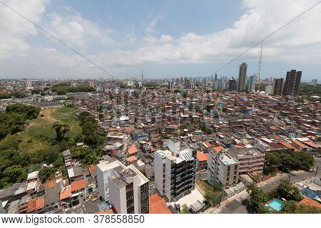 Urban Social Contrast. Buildings And Slum. Inequality