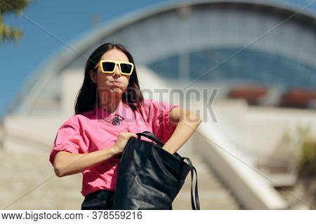 Forgetful Woman Looking For Something In Messy Purse