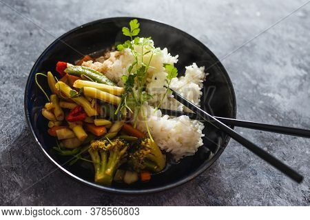 Healthy Plant-based Food Recipes Concept, Vegan Sticky Rice With Stir Fry Vegetables In Sweet And So