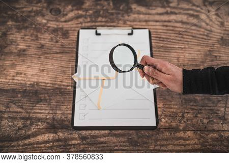 Inbox Organisation Conceptual Image, Email Icons On To Do List And Hand Holding Magnifying Glass To