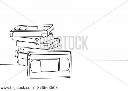 One Single Line Drawing Stack Of Retro Old Classic Vhs Analog Video Cassette. Vintage Film Storage T
