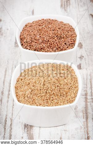 Linseed In White Glass Bowls. Healthy Food Containing Natural Vitamins, Dietary Fiber And Acids Omeg