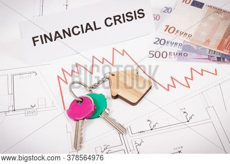Keys With Home Shape, Currencies Euro, Downward Graphs And Inscription Financial Crisis On Electrica