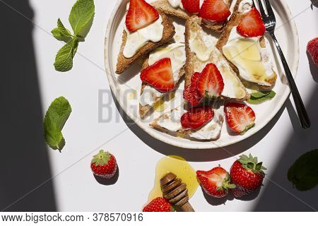 French Toast With Ricotta Cheese And Strawberries Served With Honey. Diet Delicious Summertime Snack