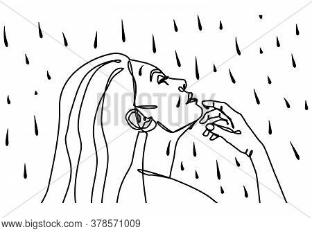 Young Girl With Long Hair Is Standing In The Rain.she Looks Forward Thoughtfully, Raised Her Hand To