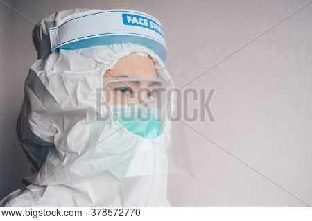 Healthcare Worker While Wearing Ppe Suit Before Working In Hospital During Covid-19 Pandemic. Ppe Is