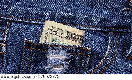 Banknote Money Twenty Us Dollar In The Mini Pocket Of Blue Jeans. Concept Of Saving Money Or Finance