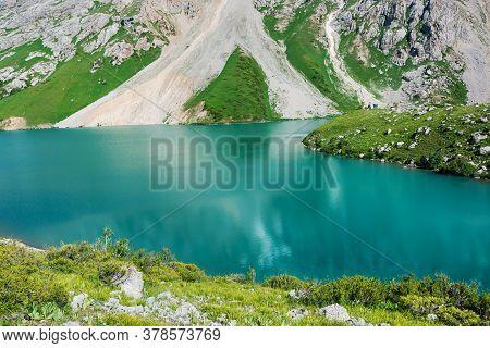 Beautiful Mountain Turquoise Color Lake Colculan. Kyrgyzstan.