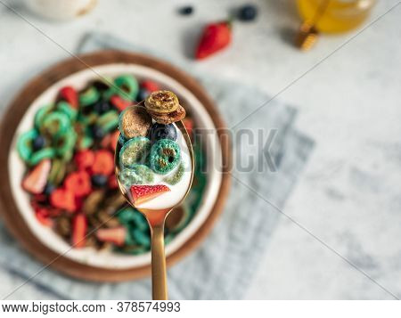 Trendy Food - Pancake Cereal. Bowl Of Colorful Mini Cereal Pancakes In Spoon With Milk. Tiny Pancake
