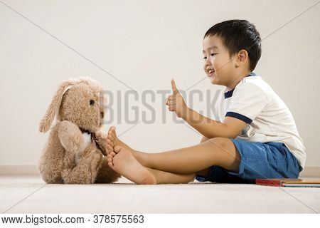 Asian Boy Talking To Teddy Bear, Vietnamese Toddler Pointing And Speaking To Stuffed Toy, Cute Kid S