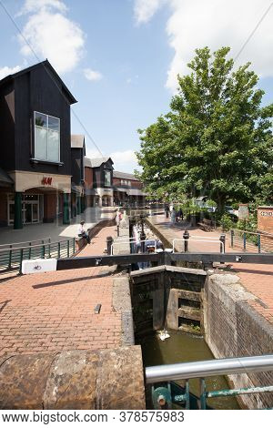 The Banbury Canal At The Castle Quay Shopping Centre With The H & M Shop In Banbury, Oxfordshire In