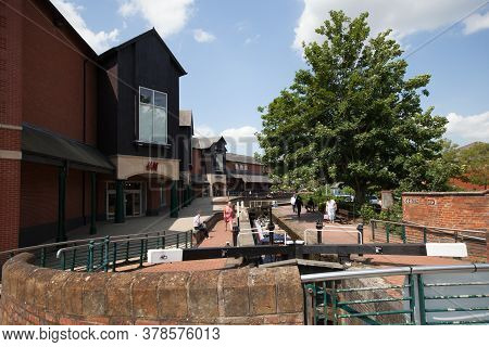 The Banbury Canal At The Castle Quay Shopping Centre With The H & M Shop In North Oxfordshire In The