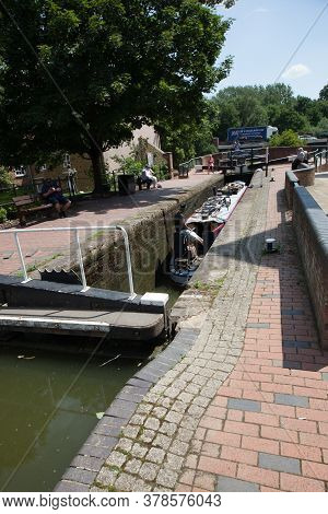 A Narrowboat Passing Through The Lock At Banbury Castle Quay Shopping Centre In Banbury, Oxfordshire