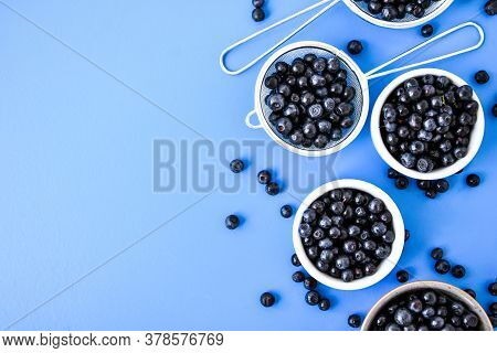 Berries. Blueberry. Forest Berries In A Bowl On Blue Background. Background With Selective Focus. Co