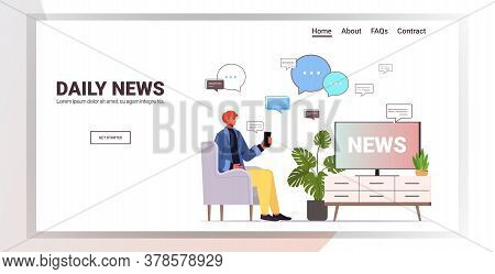 Man Watching Tv And Discussing Daily News In Mobile Chatting App Chat Bubble Communication Concept P