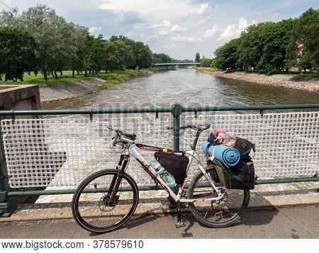 July 20th 2020, Podebrady, Czechia. Heavy Loaded Mtb On The Bridge Over Elbe River In Podebrady