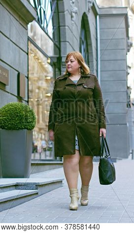 Cute Simple Woman With Red Hair Of Size Plus Size Walks Through The Shopping Chooses Things Like Sho
