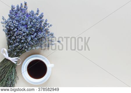 Lavender Bouquet And Coffe On Beige Background. Top View, Flat Lay,copy Space. Morning Mood Concept