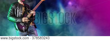 Guitar Player Performs On Stage. Rock Guitarist Plays Solo On An Electric Guitar. Artist And Musicia